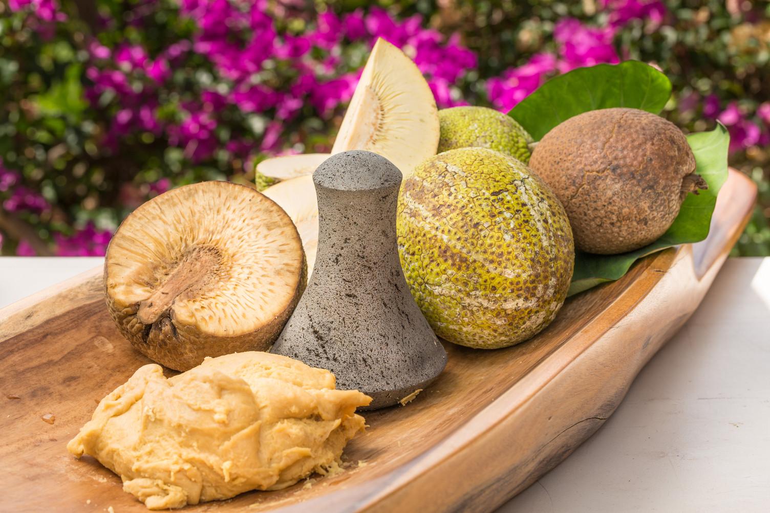 Ulu (breadfruit) pounded into paiai using a poi pounder