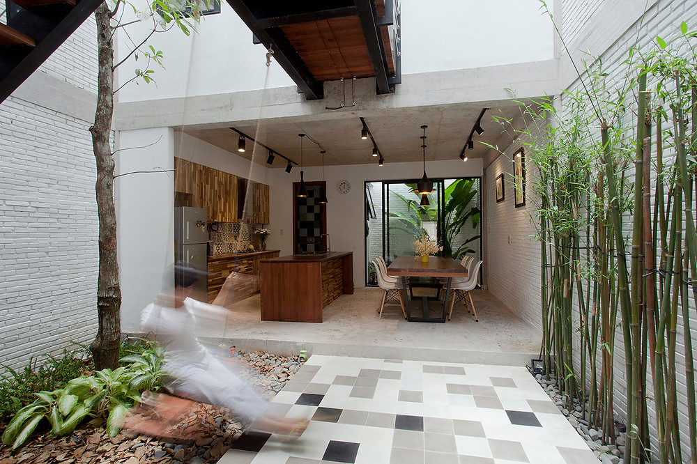 A home courtyard. B House by I.House Architecture and Construction