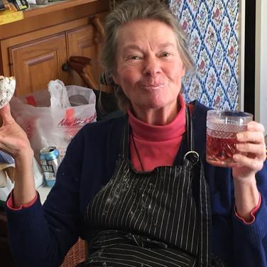 satisfied customer drinking tea and donut
