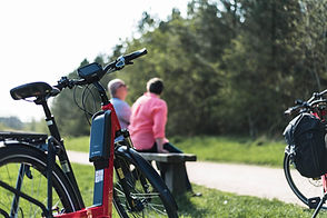 Couple enjoying a stop on their EBike cycling holiday