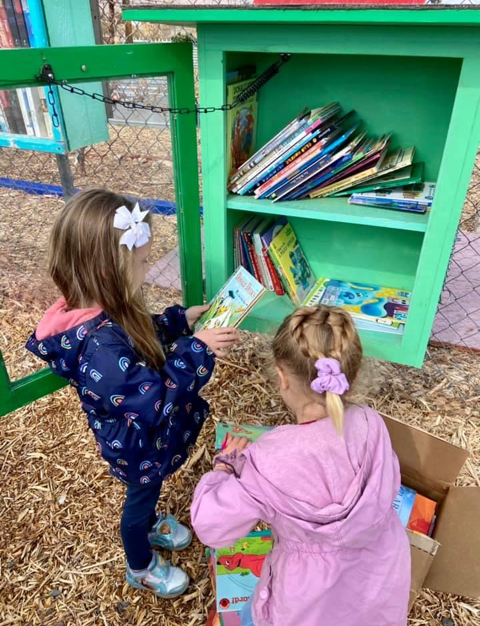 Helping Dig It refill the Children's Little Free Library.  It's a popular place to take a book, bring a book!