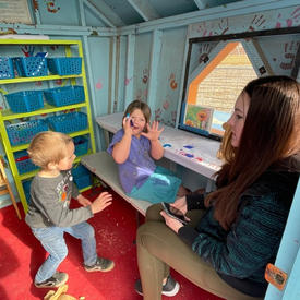 Playing in the playhouse
