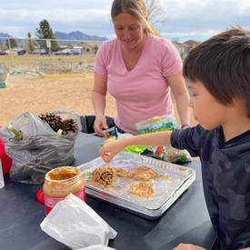 Making Birdfeeders with pine ones, peanut butter and bird seed