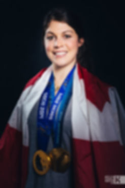 Rebecca Johnston sporting her two Olympic gold medals from Vancouver and Sochi.
