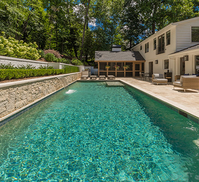 Sparkling pool with lush landscaping