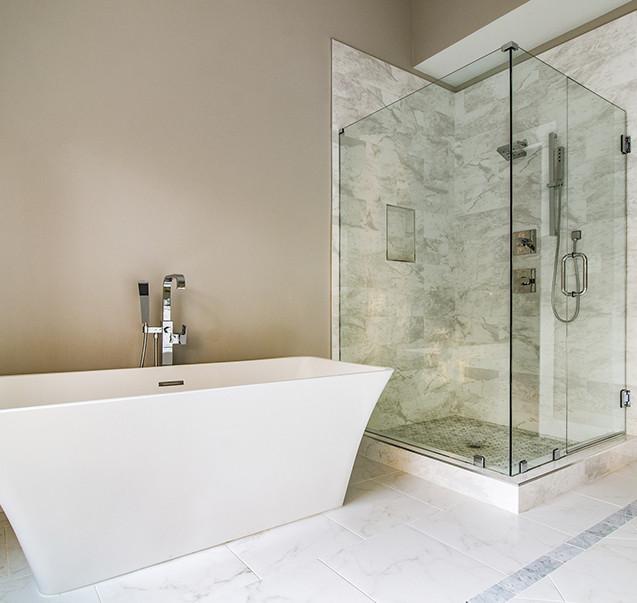 Frameless shower and freestanding tub
