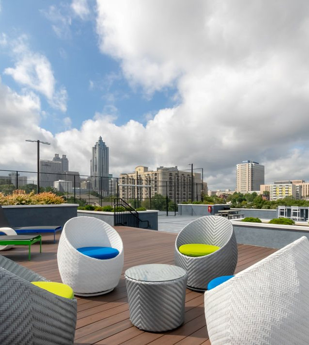 Rooftop seating area with ATL skyline