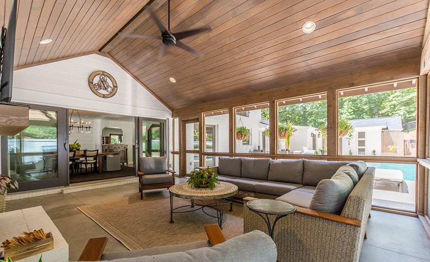 Expansive screened porch with sliding doors to dining room/kitchen