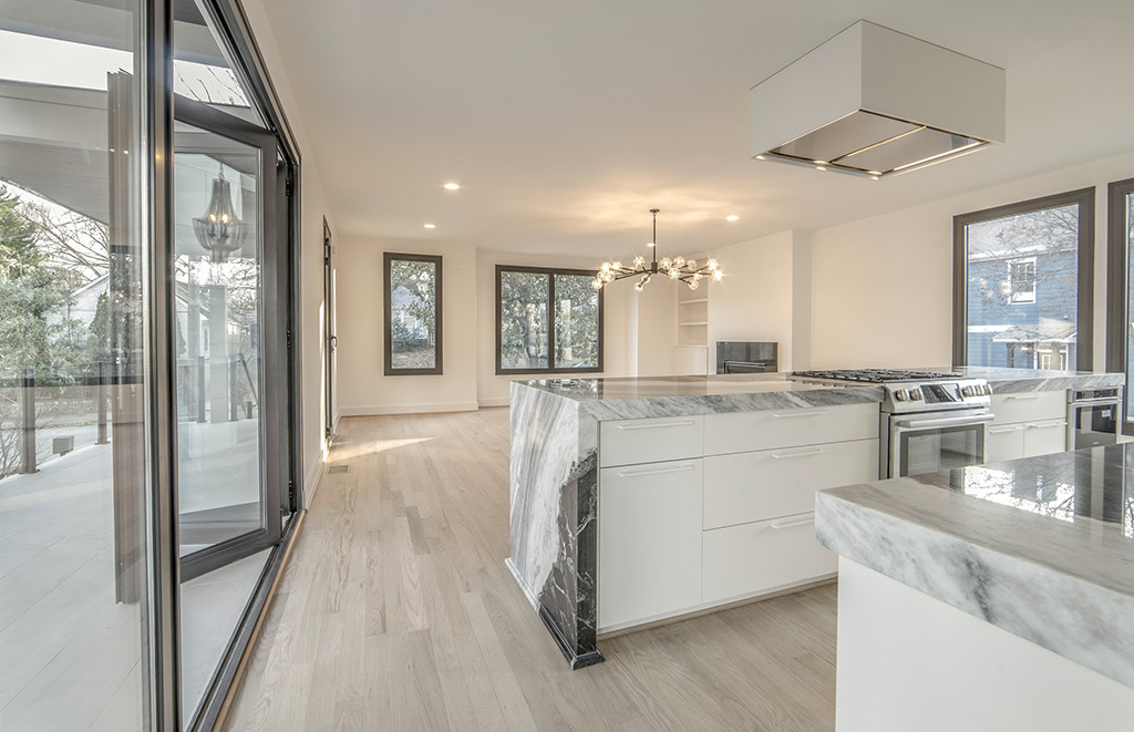 An open kitchen with easy access to outdoor dining area