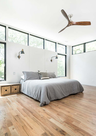 An open and airy master bedroom