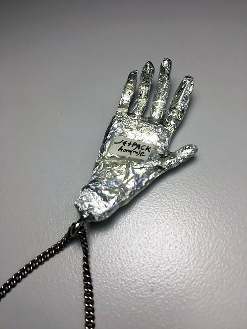 "JETPACK HOM(M)E ALUMINUM SCULPTED ""HAND"" RESIN NECKLACE"