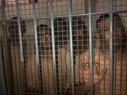 Aslym Seeker Men behind IDC bars
