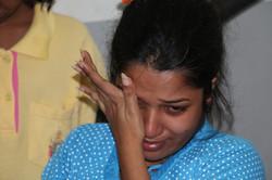 Woman crying at IDC