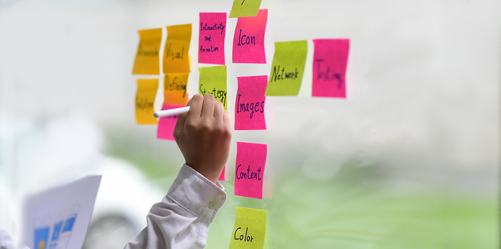 Canva - Person Writing on Sticky notes.j