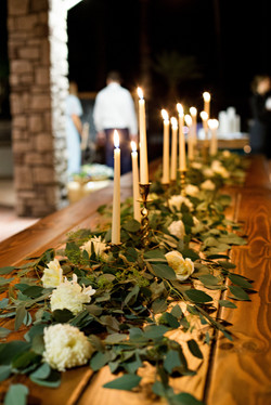 candlesticks, greenery and farmtable