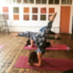 Forearm stand in yoga class at Love and Light Shala Yoga Studio