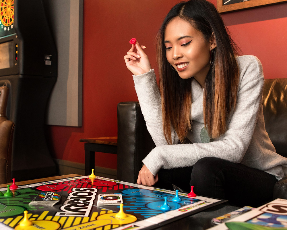 WNY Model Annisa Nowicki plays a board game at Big Ditch Brewing Company