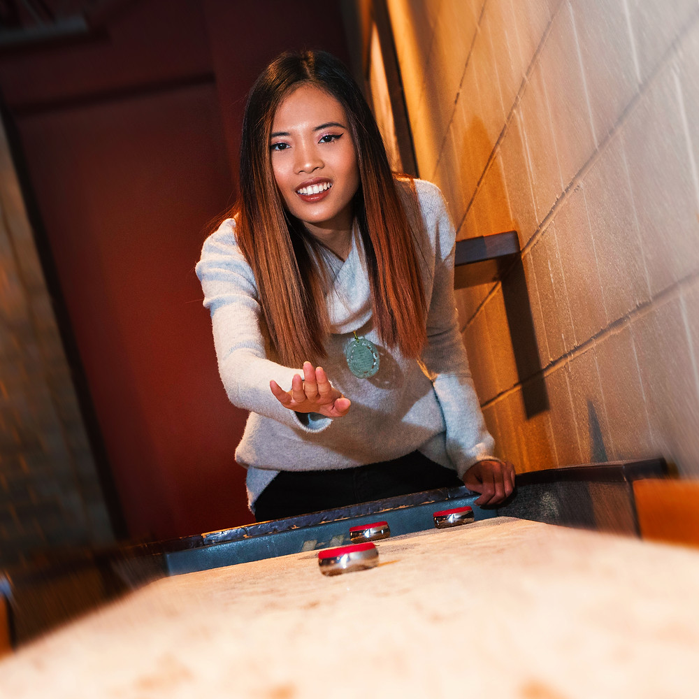 WNY Model Annisa Nowicki plays shuffleboard at Big Ditch Brewing Company