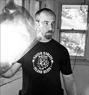 Scott Pillsbury ajusting a light on set