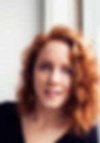 Kennedy Knopf - window headshot - smilin