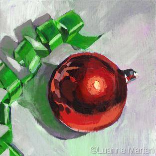 Red Christmas ball, green curling ribbon