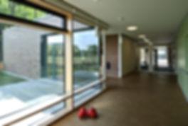 Architekt Kindergarten, Architekt Kinderkrippe, Kindergarten Architektur, Kindergarten Flur, Spielflur, Ziegelfassade, Volker Schmidt Architekt, Birke-Multiplex-Fassade, Pfosten-Riegel-Fassade, Klinkerfassade