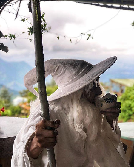Gandalf drinking coffee at the Guatemalan shire at Hobbitenango