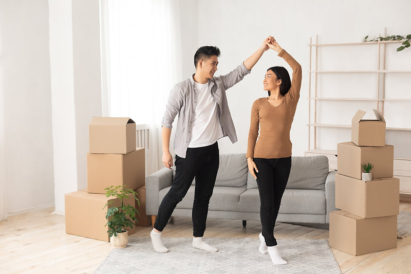 happy-asian-man-and-woman-dancing-in-new