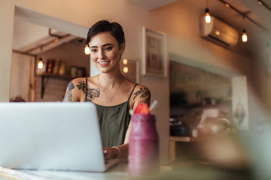 Woman entrepreneur working on laptop com