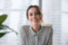 Smiling businesswoman looking at camera