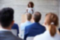 Businesswoman Addressing Delegates At Co