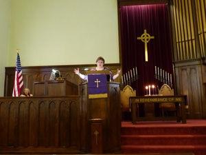 Michelle preaching.jpg