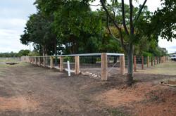 Round posts, cattle rail + dog wire