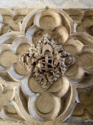 detail from the stone fireplace in the Tithe Barn