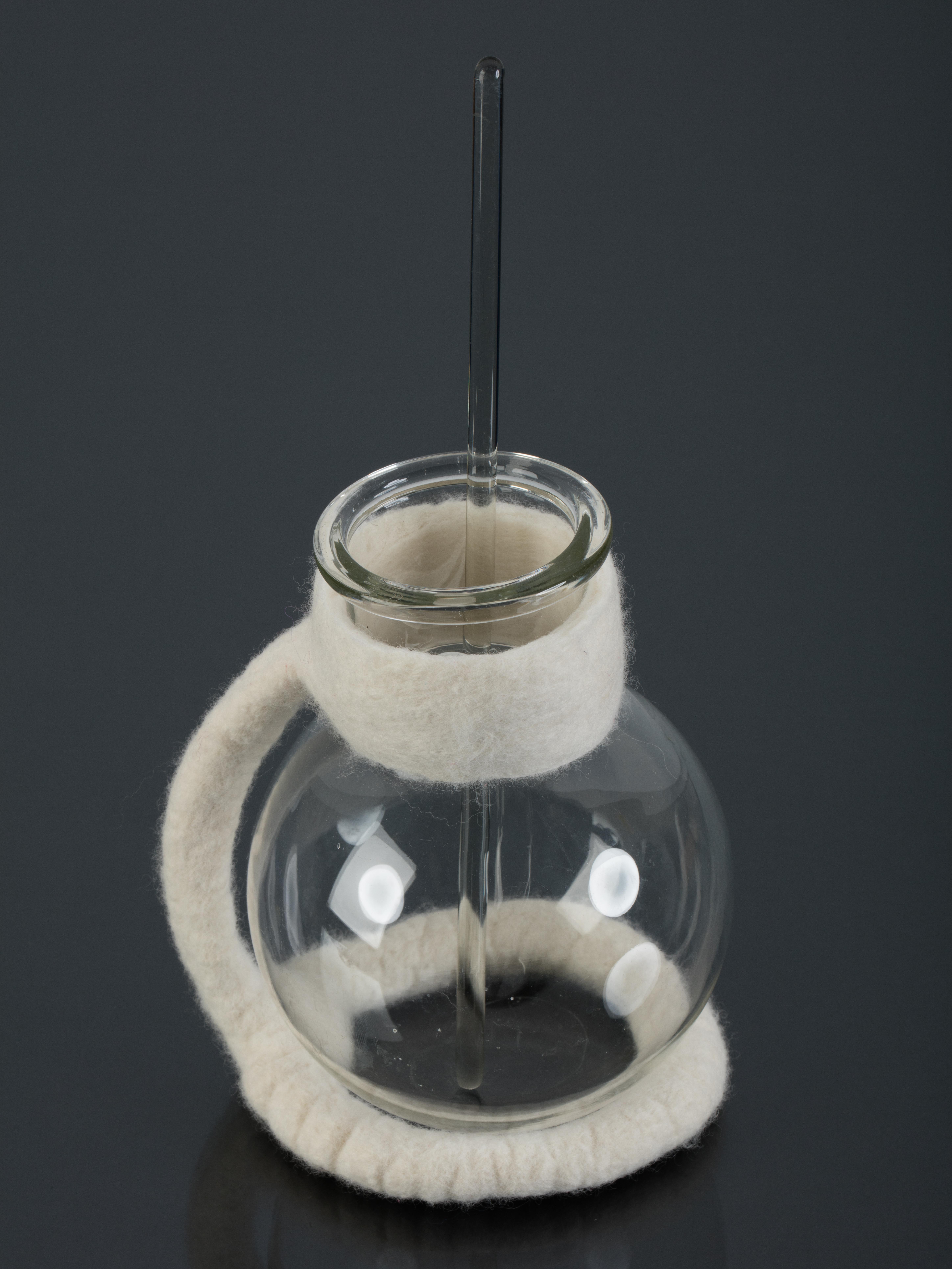 Felt and lab glass vessel