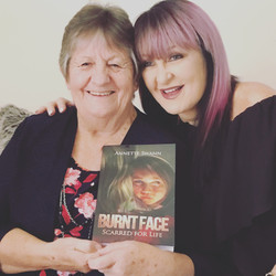 Mum and I holding first copy of book