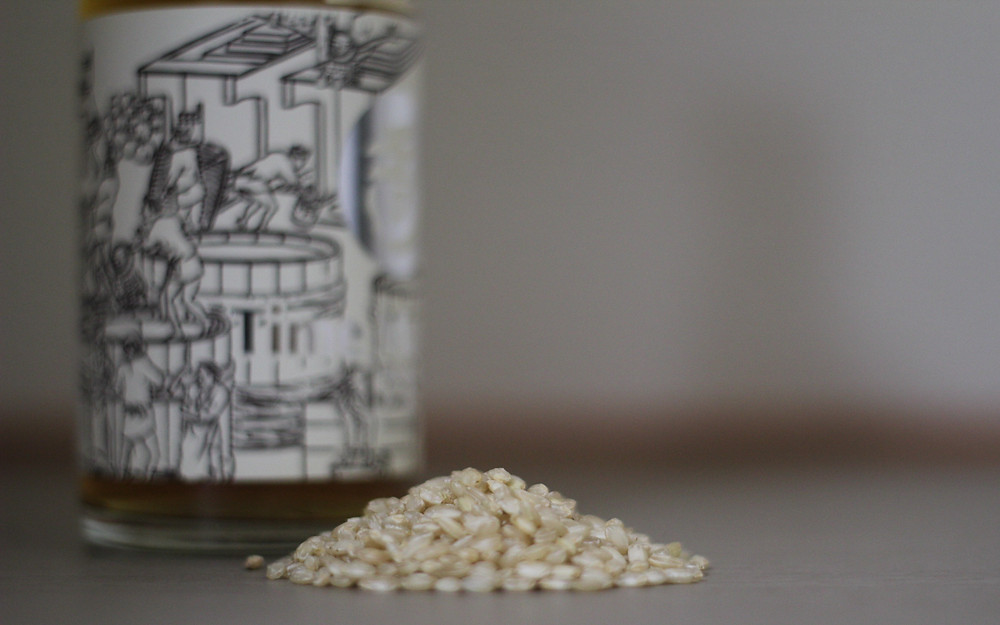 Unpolished rice next to Time Machine 1712