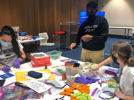 Professor Minna Ng's service learning students make educational activities for children in Durham