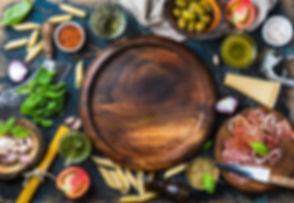 Italian food cooking ingredients on dark