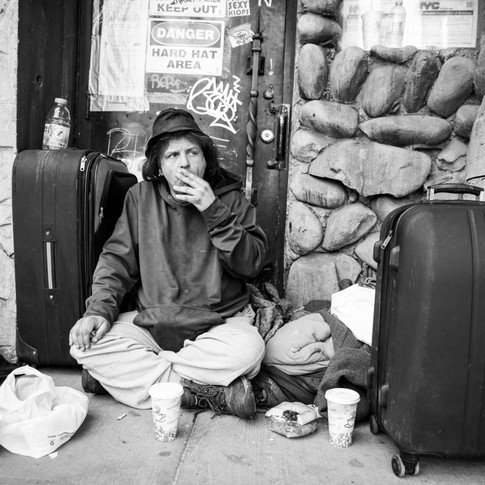 I met Deuce on 57th street on a Sunday afternoon. I had approached him asking if I could get to know him and take some photos of him. He was very enthusiastic about it! He put one of his blankets on the ground, I got us some coffee and we started our chat.