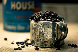 coffee beans on stainless steel cup_edited.jpg