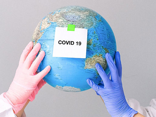 hands-with-latex-gloves-holding-a-globe-