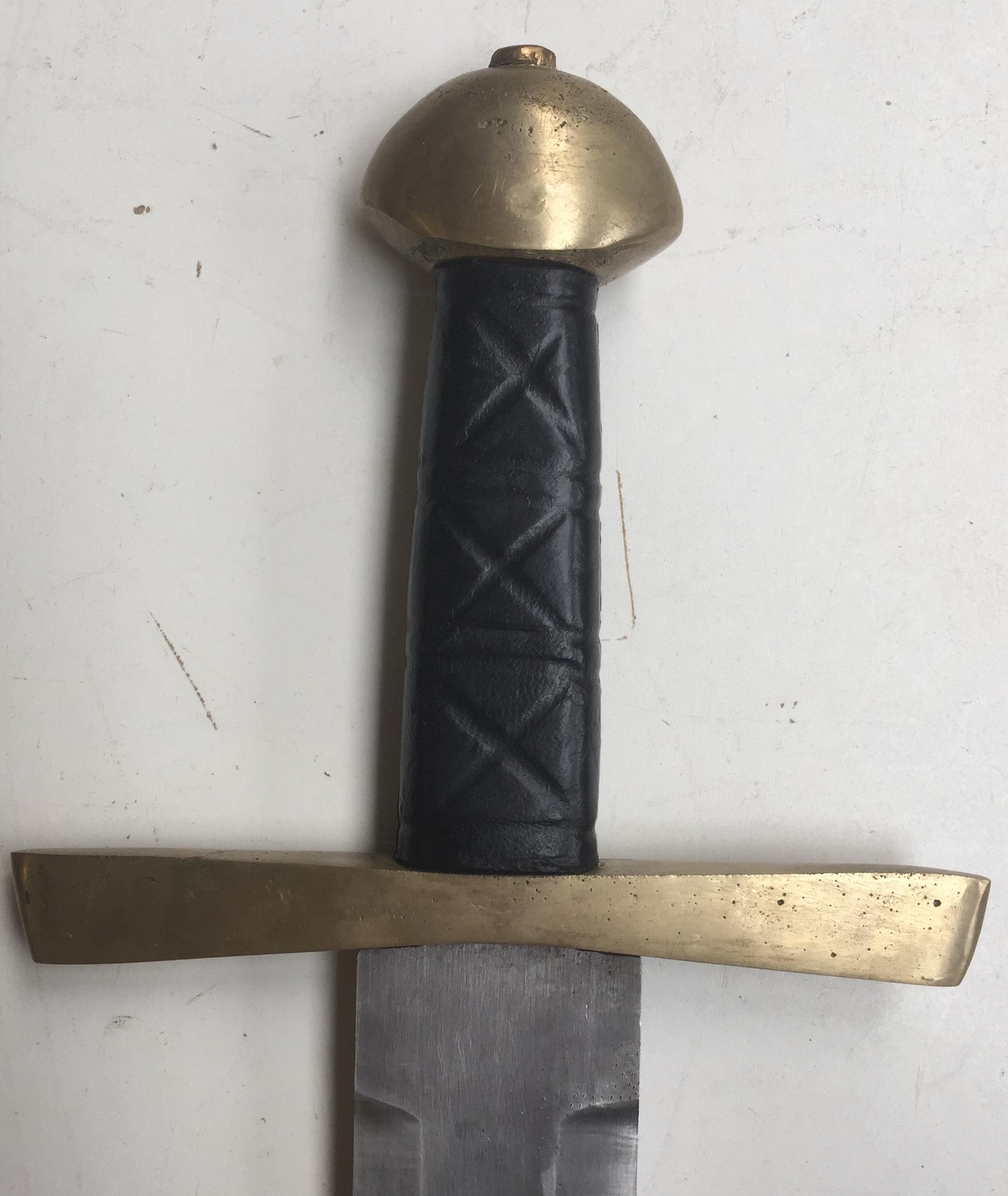 Brass walnut pommel black grip