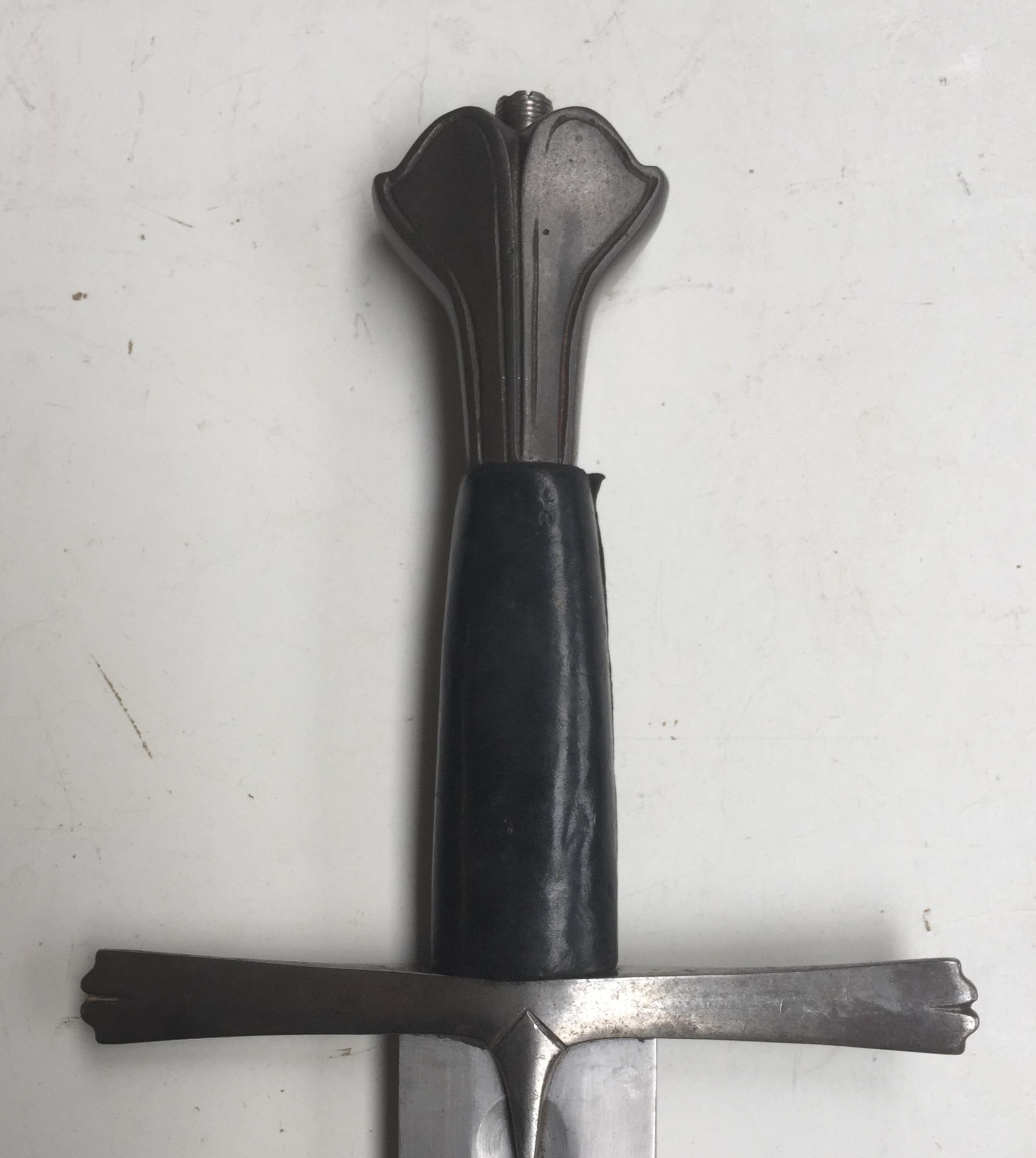 Fluted steel pommel