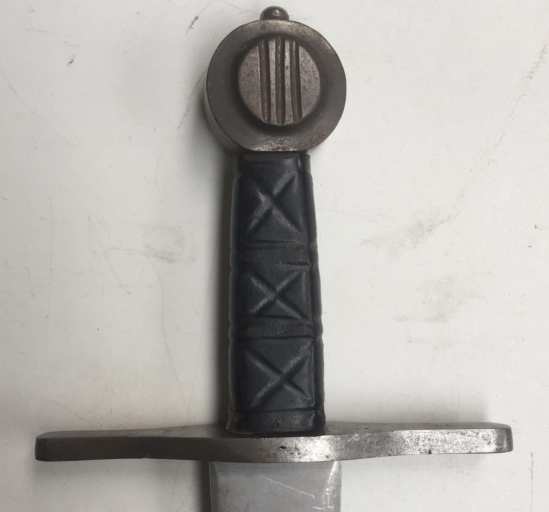 Round steel pommel