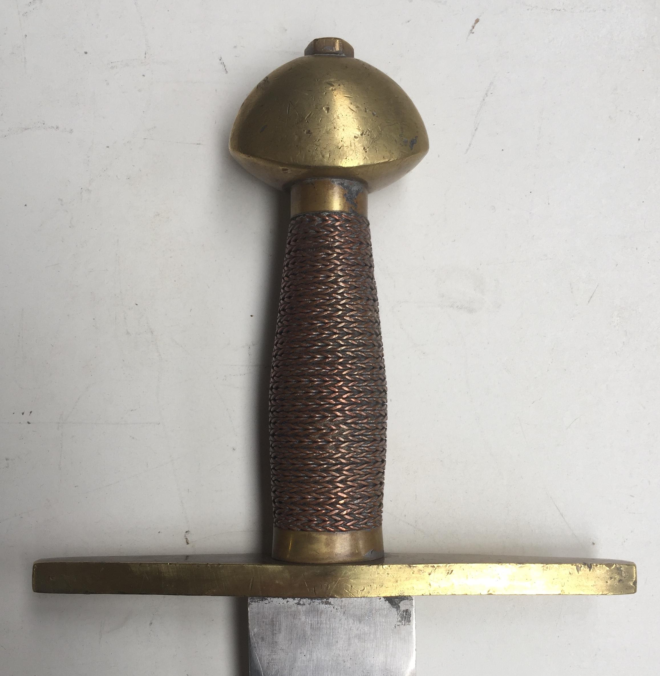 Brass walnut pommel with wire grip