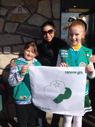 Girl Scouts showing their love for Roller Derby