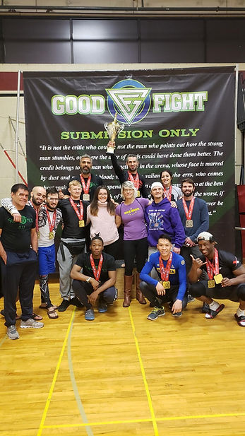 gracie team photo with trophie.jpeg