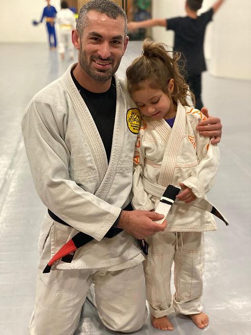 Zach with kid with stripe promotion.jpeg