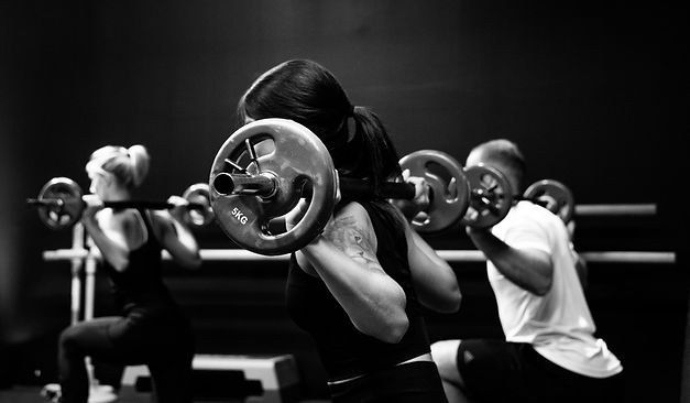 Women training with weights